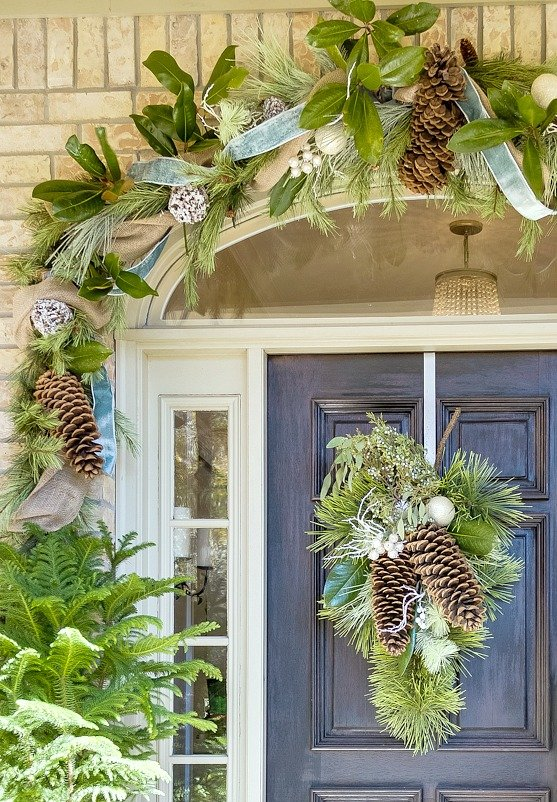 Christmas front porch garland mixed with magnolia leaves and sugar pine cones.