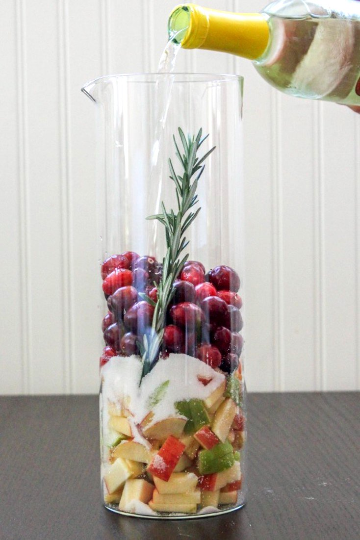 holiday spirit in this Cranberry and Rosemary White Christmas Sangria ...