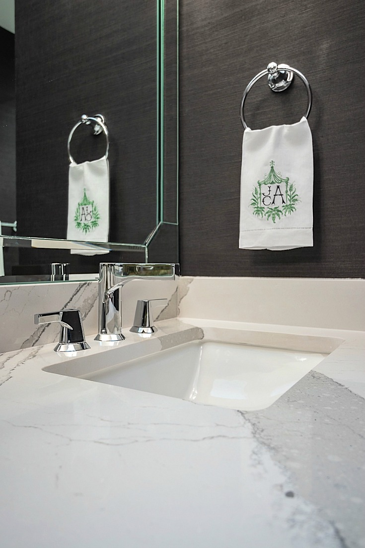 Quartz bathroom countertops and Zura Faucet by Delta Faucet.