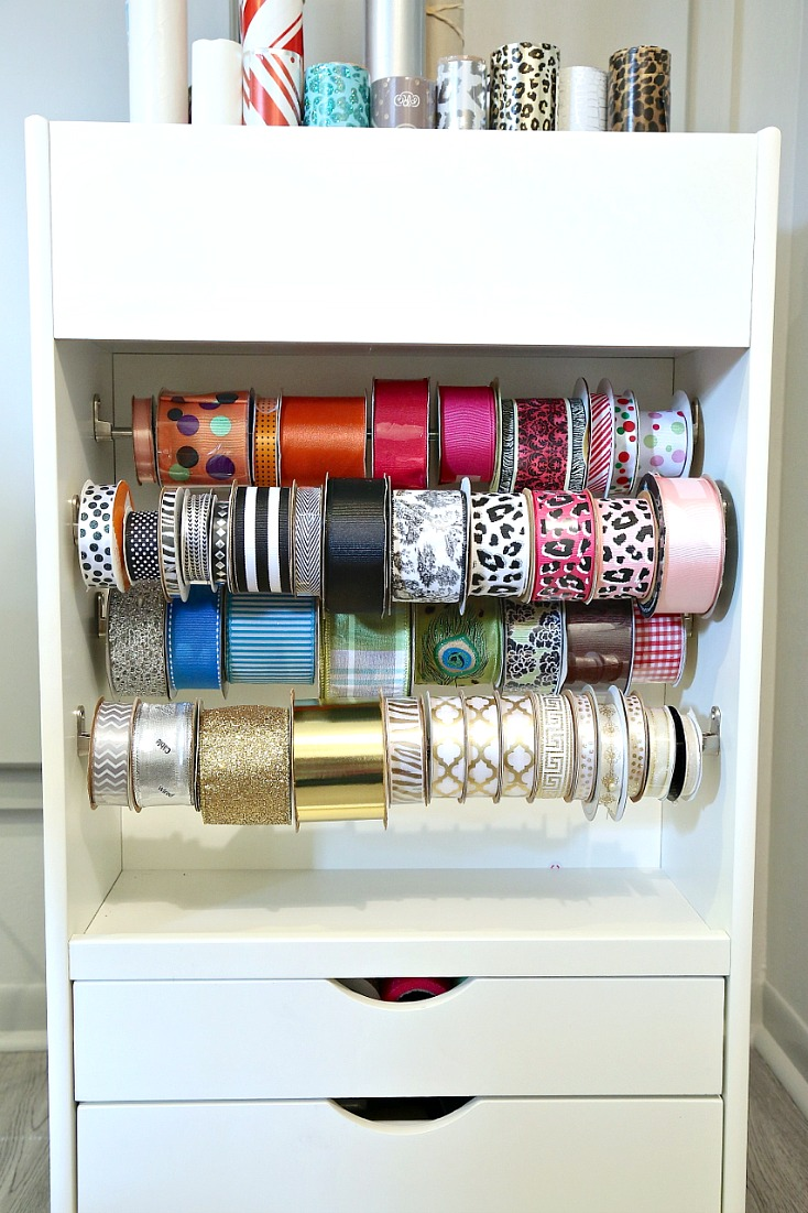 Rolling gift wrap cart that holds over 45 spools of ribbon and 25 rolls of gift wrap.