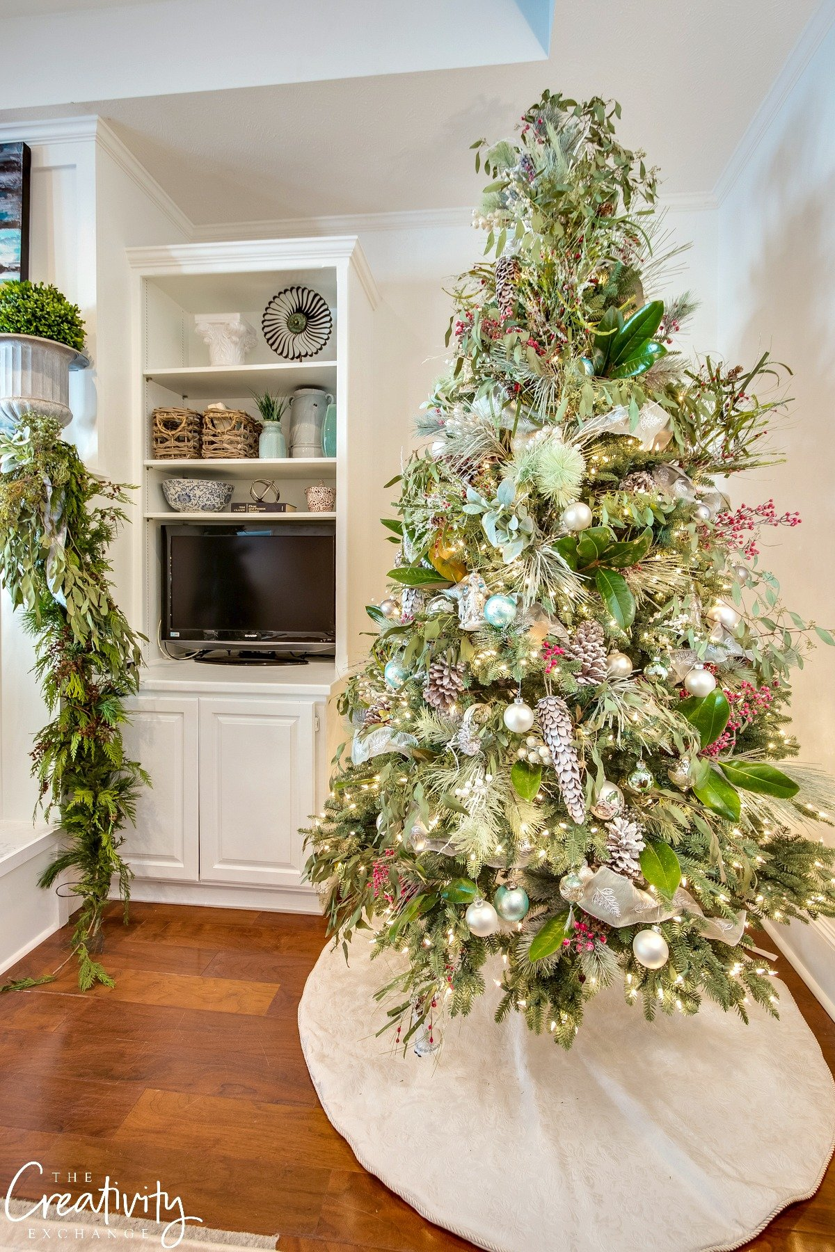Winter wonderland Christmas tree mixed with magnolia leaves and eucalyptus