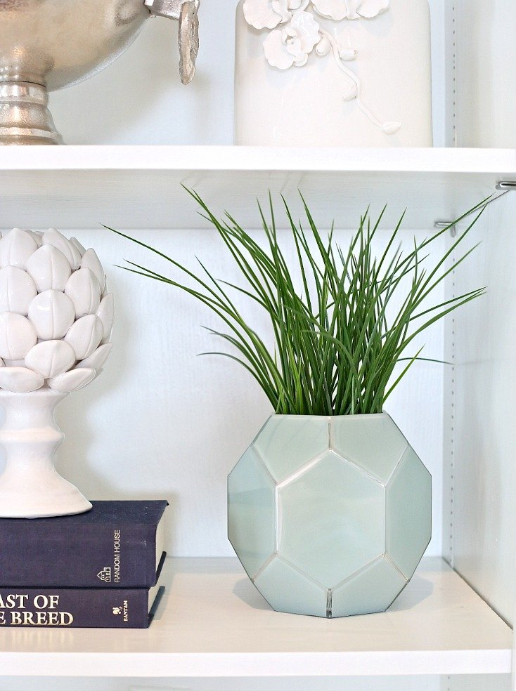 Cut faux spiked greenery at the base and slip into decorative containers.