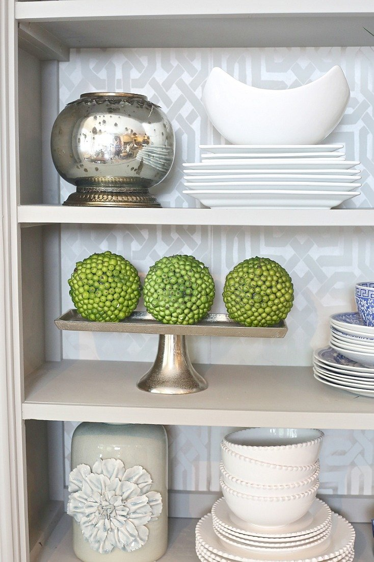 Green Dried Berry Balls Layered in Kitchen Bookshelf.