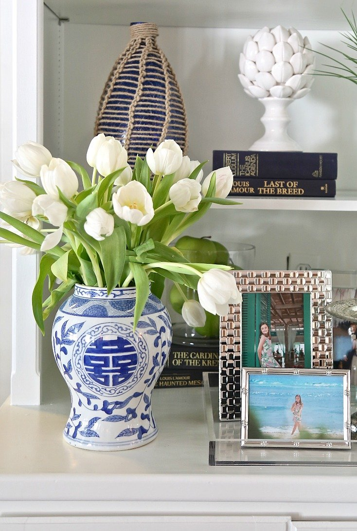 Slip a narrow vase into a big vase to hold arrangement together.