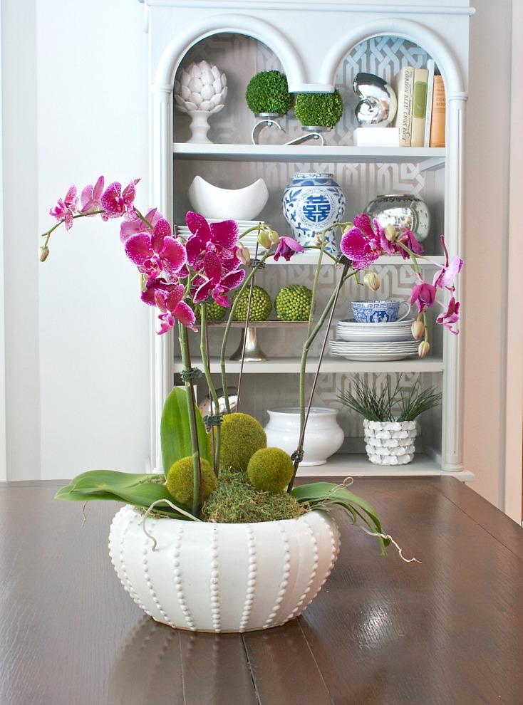 Slip moss balls into orchid arrangements.