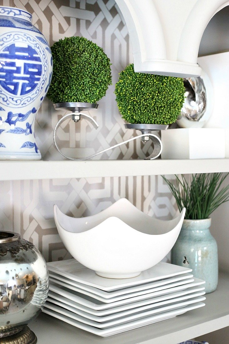Slip moss balls onto candle holders and work into shelves.
