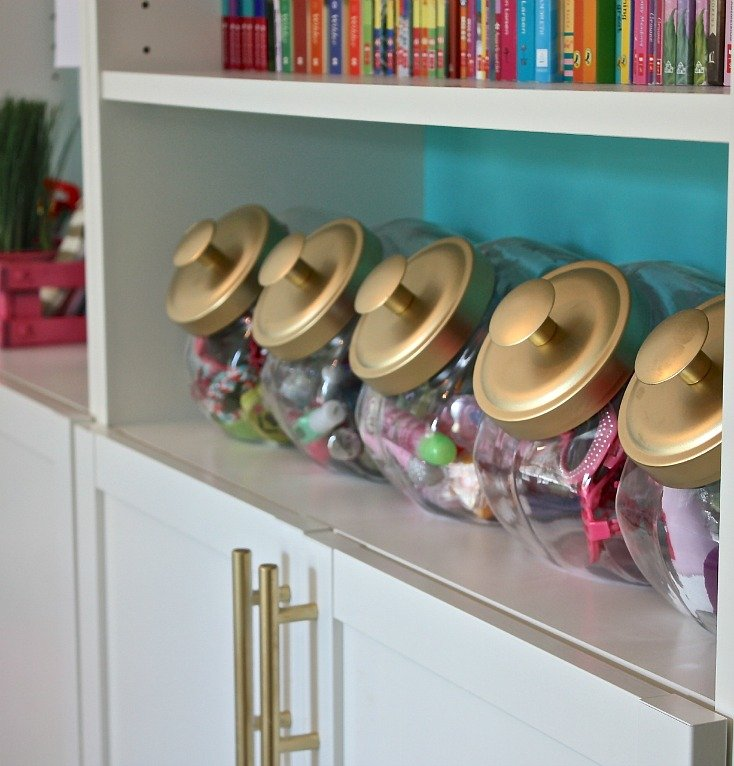 Candy bins with lids are a great way to organize kid stuff.