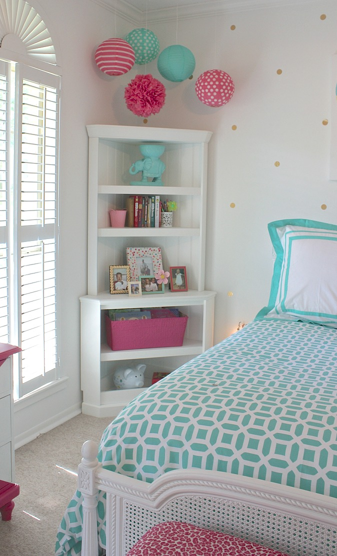 Maximize space in kids rooms with corner storage shelving.