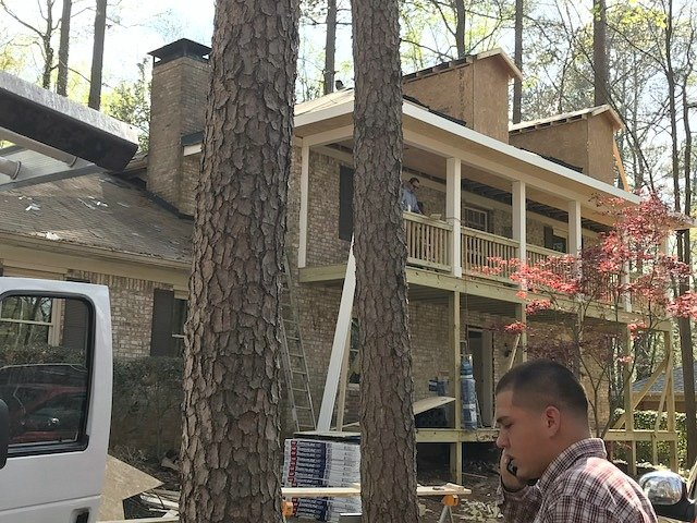 Two story brick home exterior renovation.