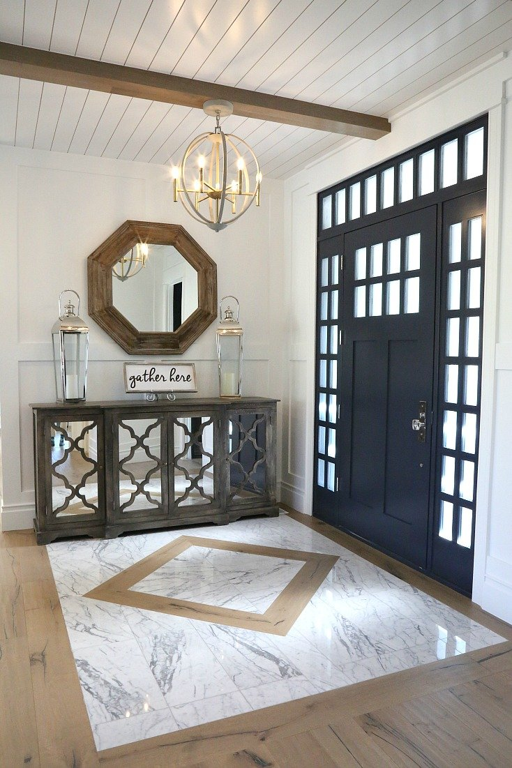 Beautiful entry way with marble and wood floor mix.