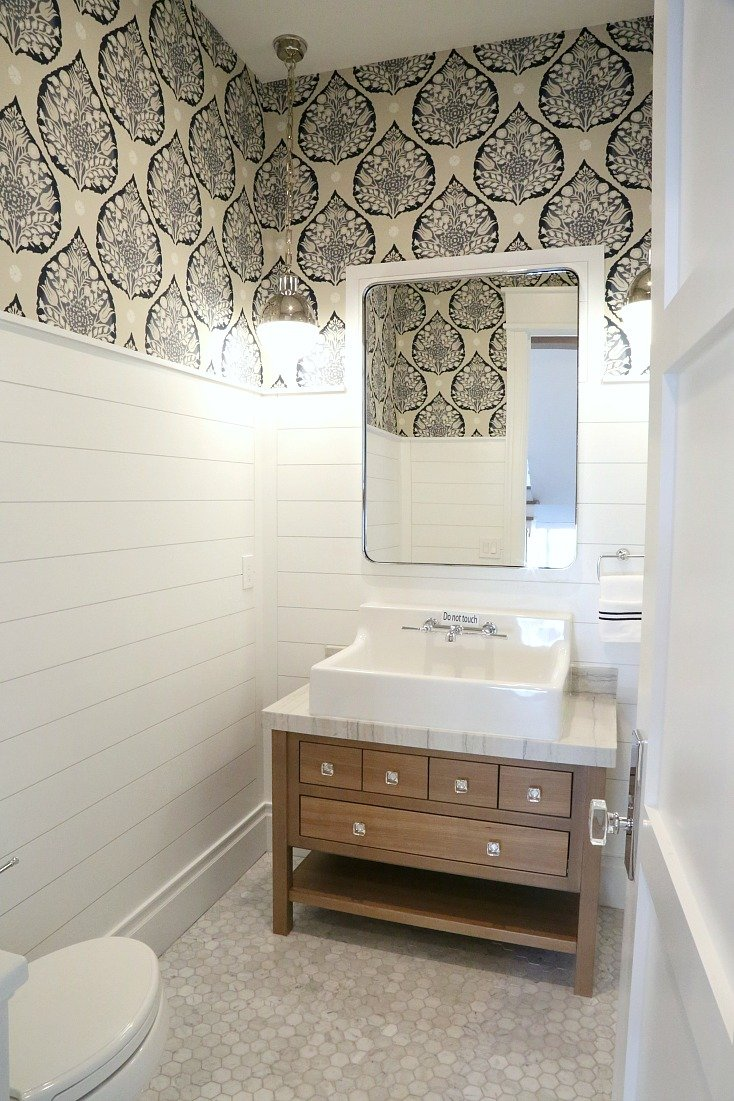 Stunning powder room with shiplap and wallpaper. Silverhawk Enterprises.