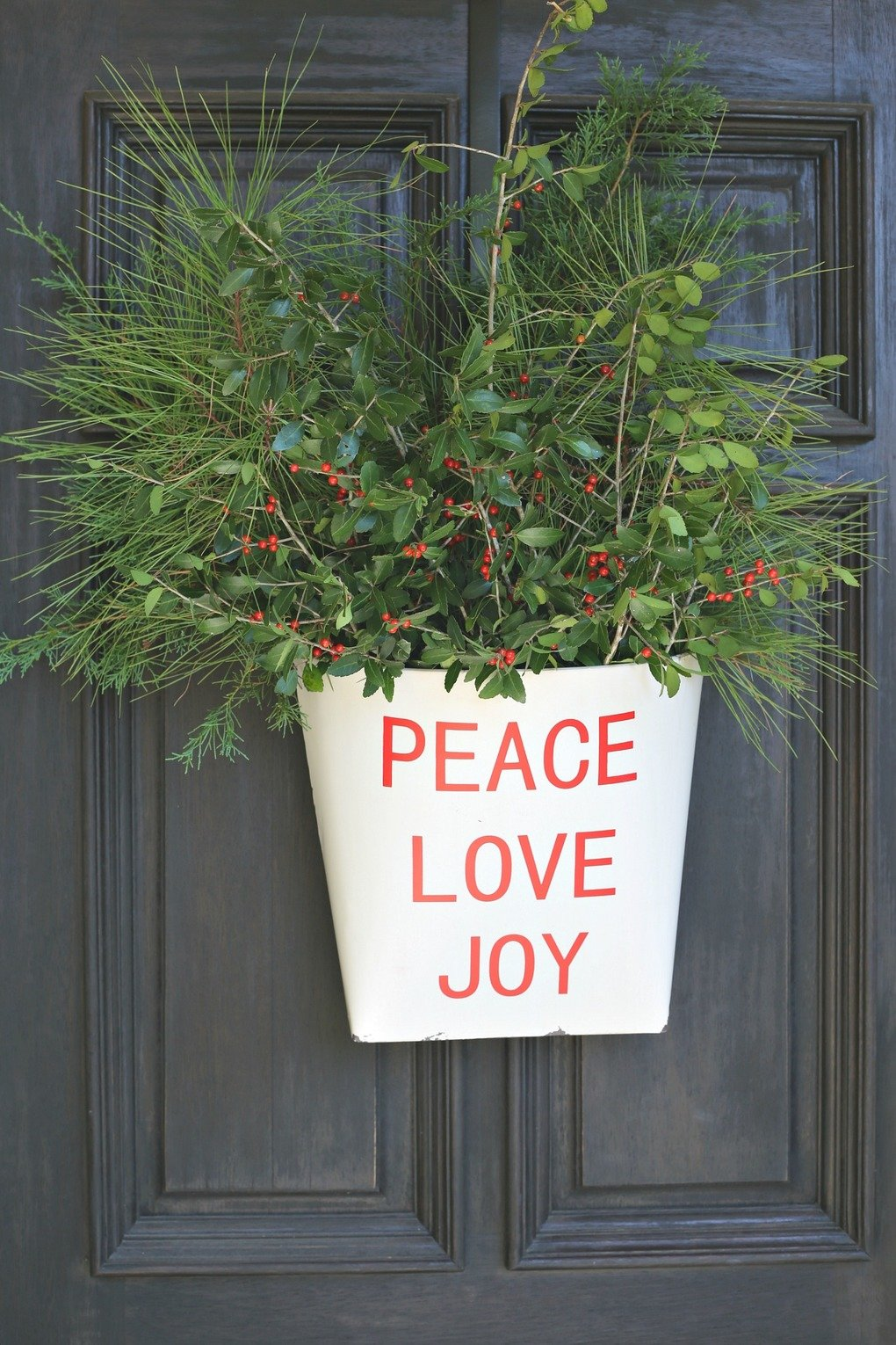 Metal Christmas Wall Bucket Filled with Greenery.