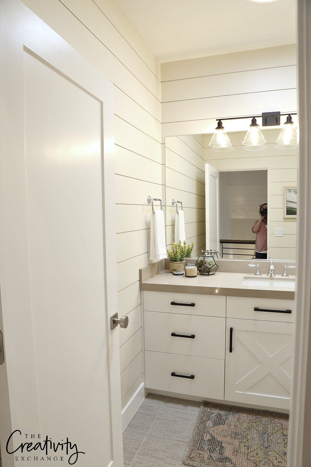 Painted shiplap wall in bathroom.