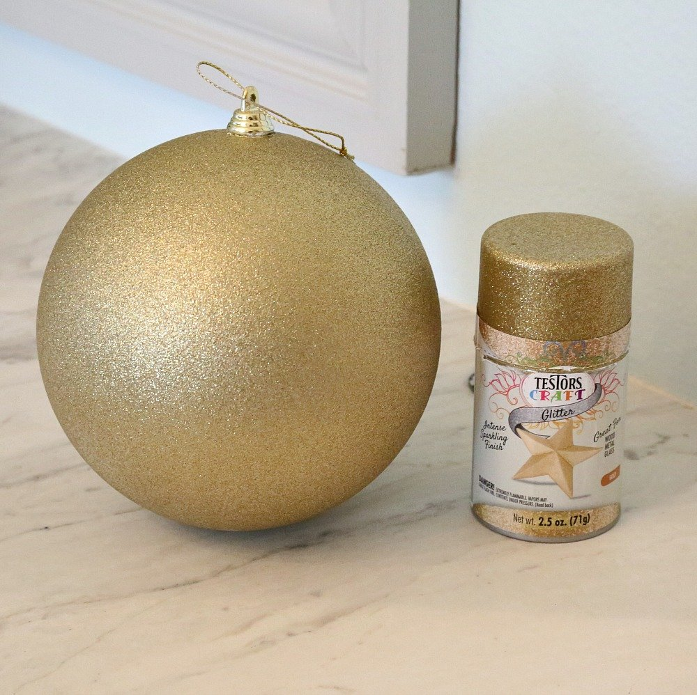 Testors Paint Gold Glitter Spray Paint on Christmas Ornament.