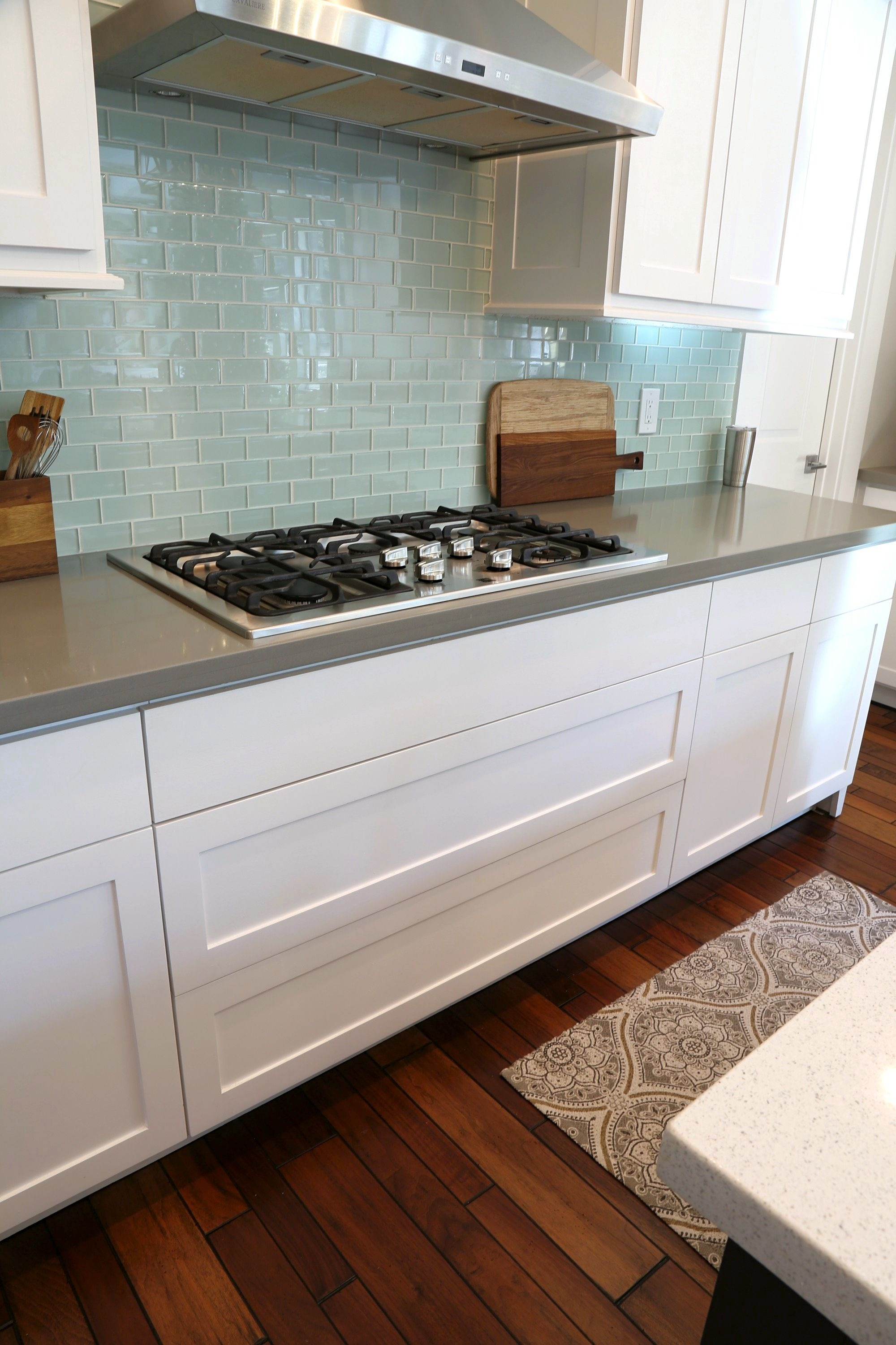 Wide kitchen drawers under stove top.