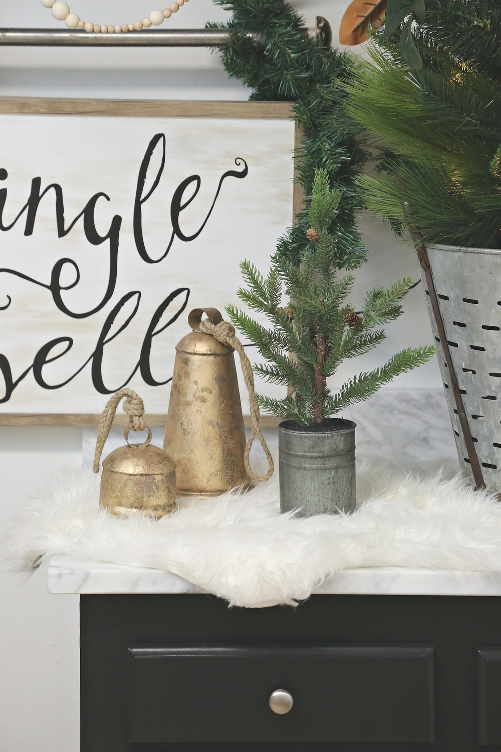 Christmas bells and tree decorated in laundry room