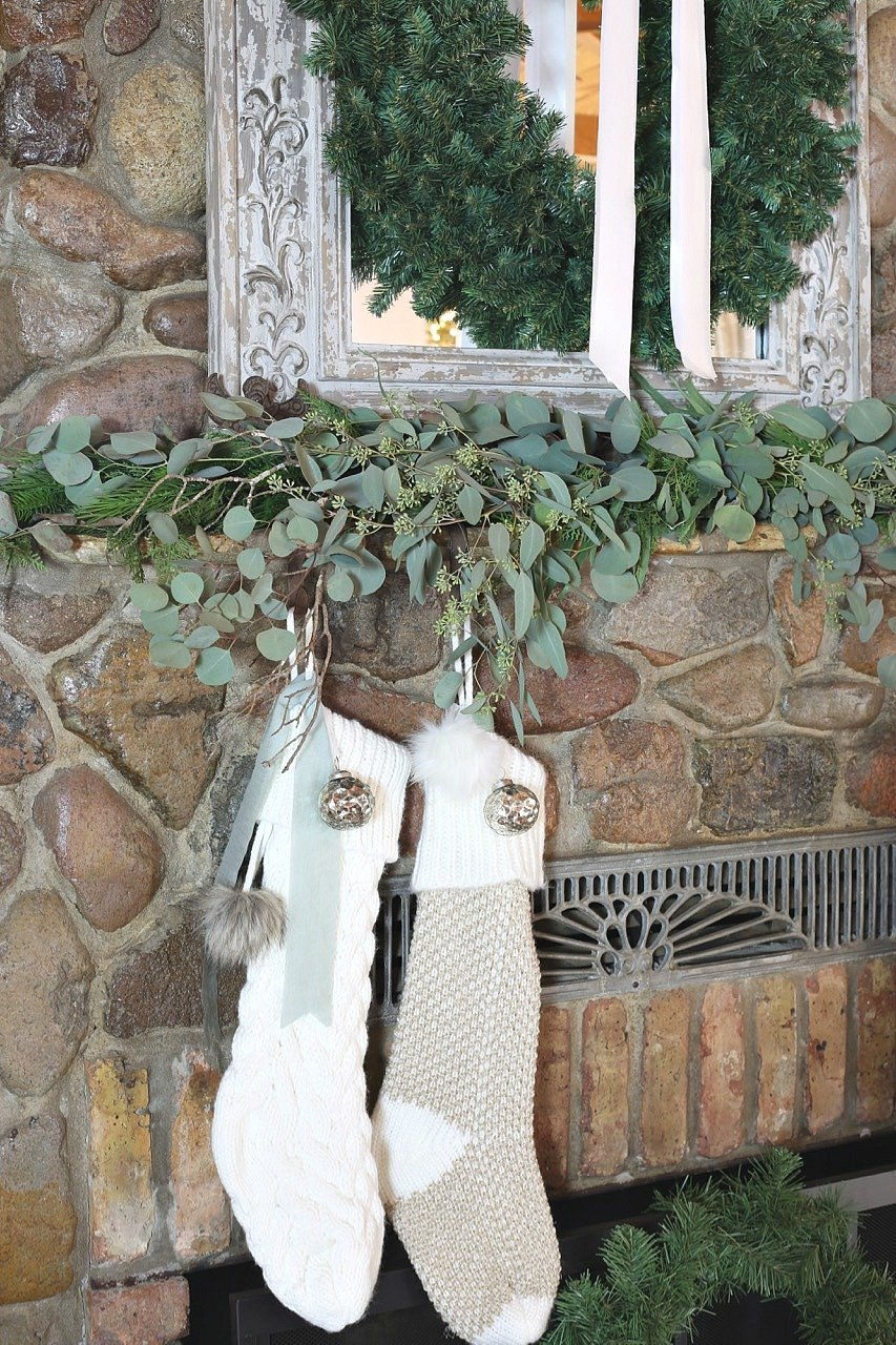 Christmas mantle with eucalyptus and stockings