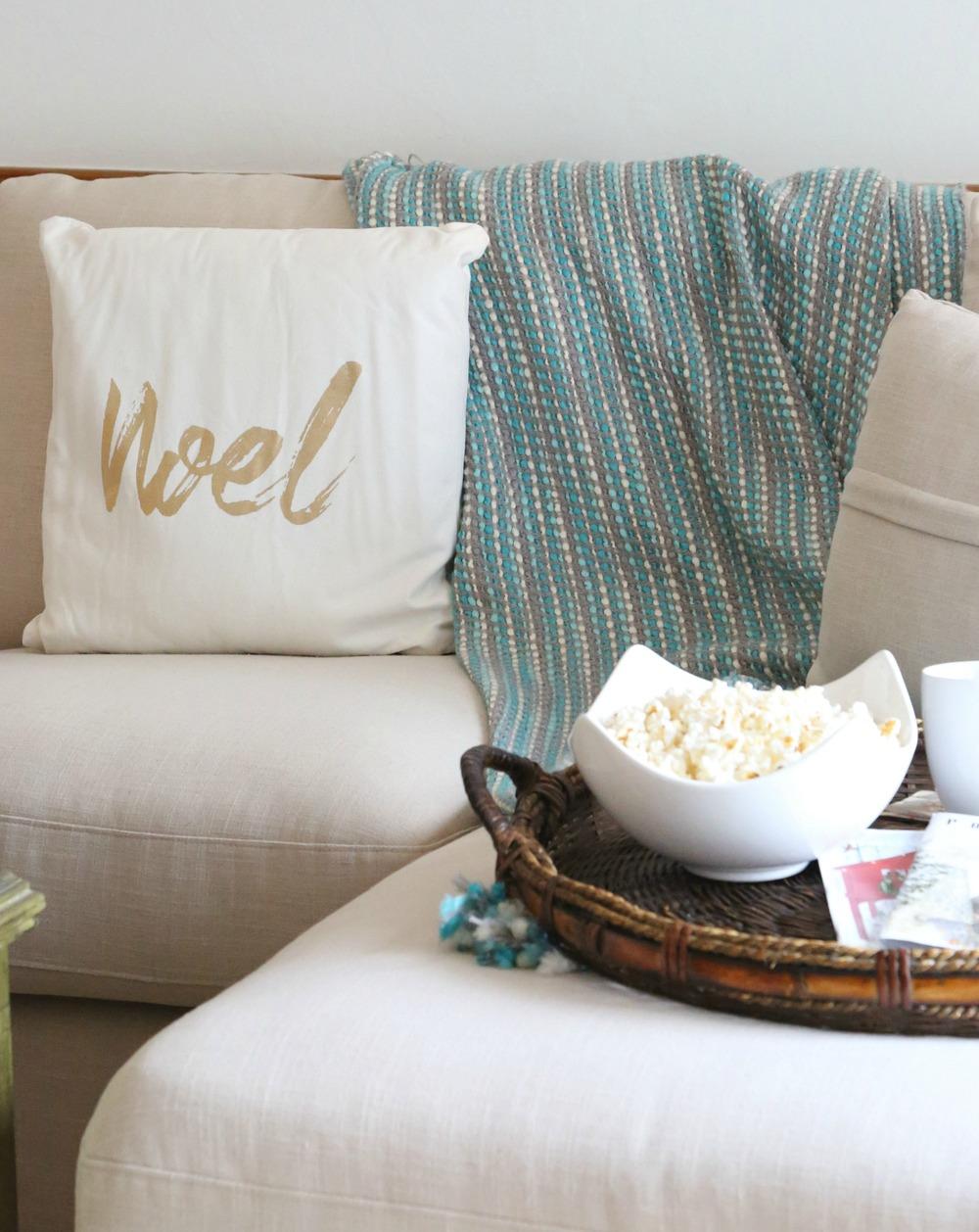 Christmas pillow on sofa.