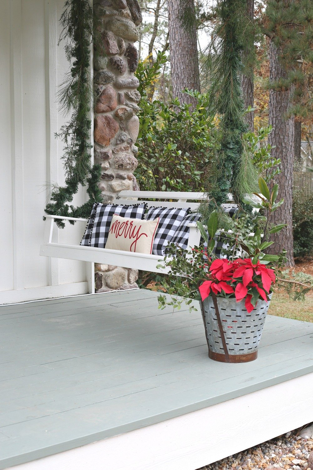 Christmas porch swing decorated with garland