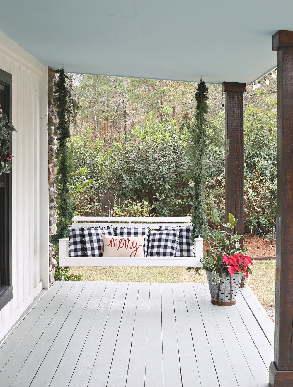 Christmas porch swing wrapped in Garland