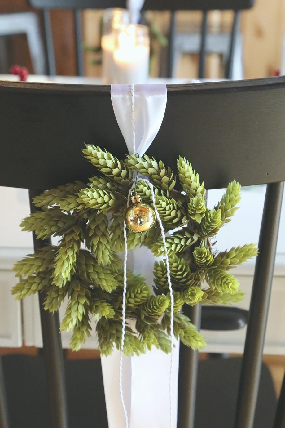 Christmas wreath on chair.