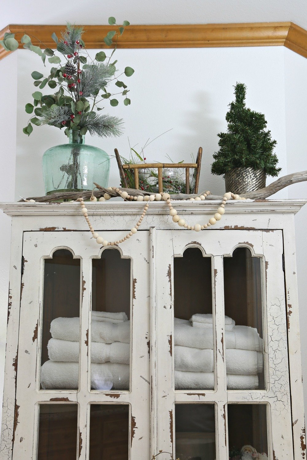 Distressed hutch decorated for Christmas