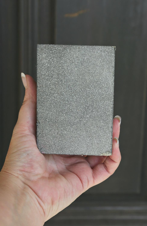 Fine grit sanding sponge.