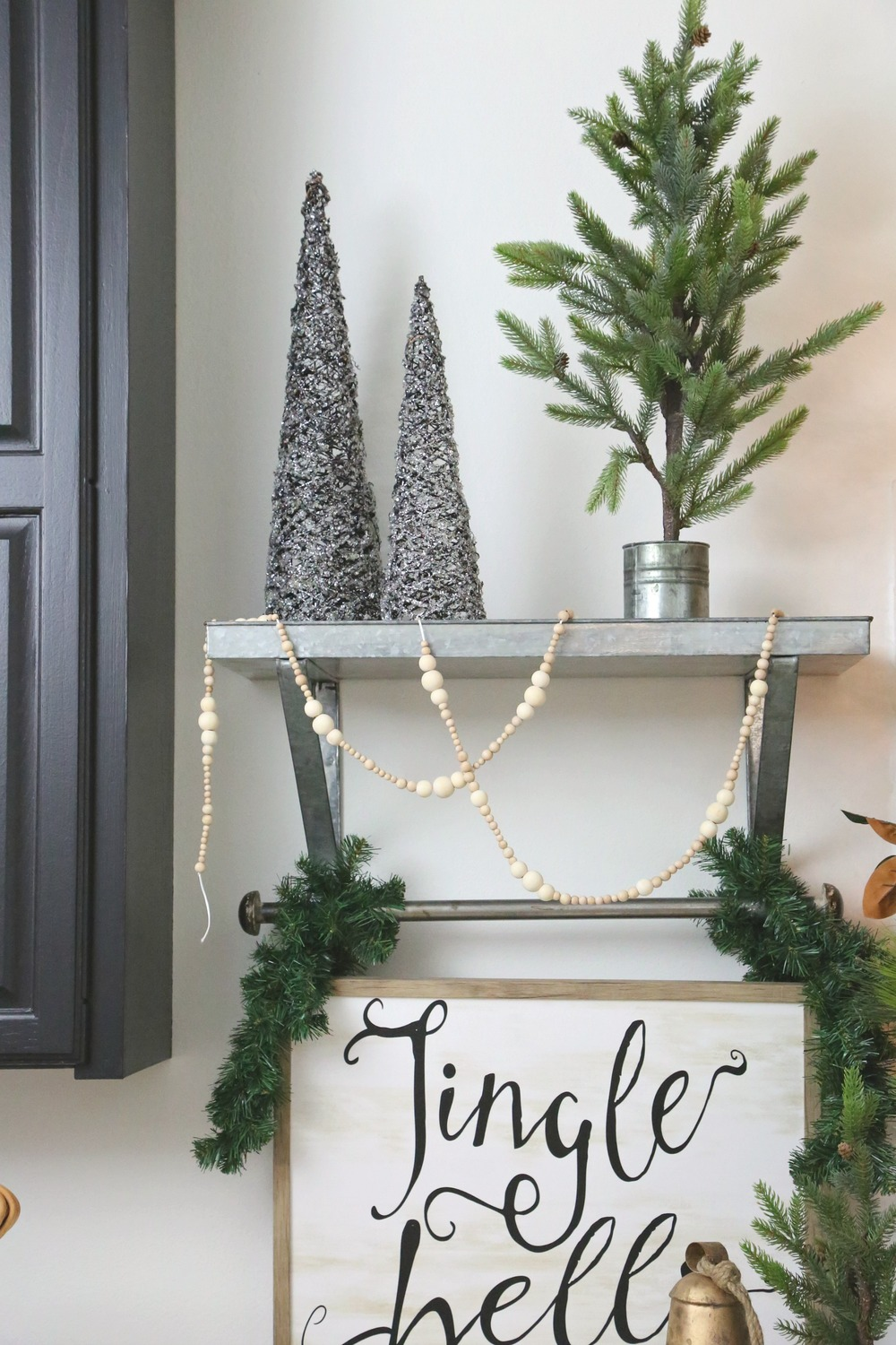 Jingle bell sign with Christmas tree cones