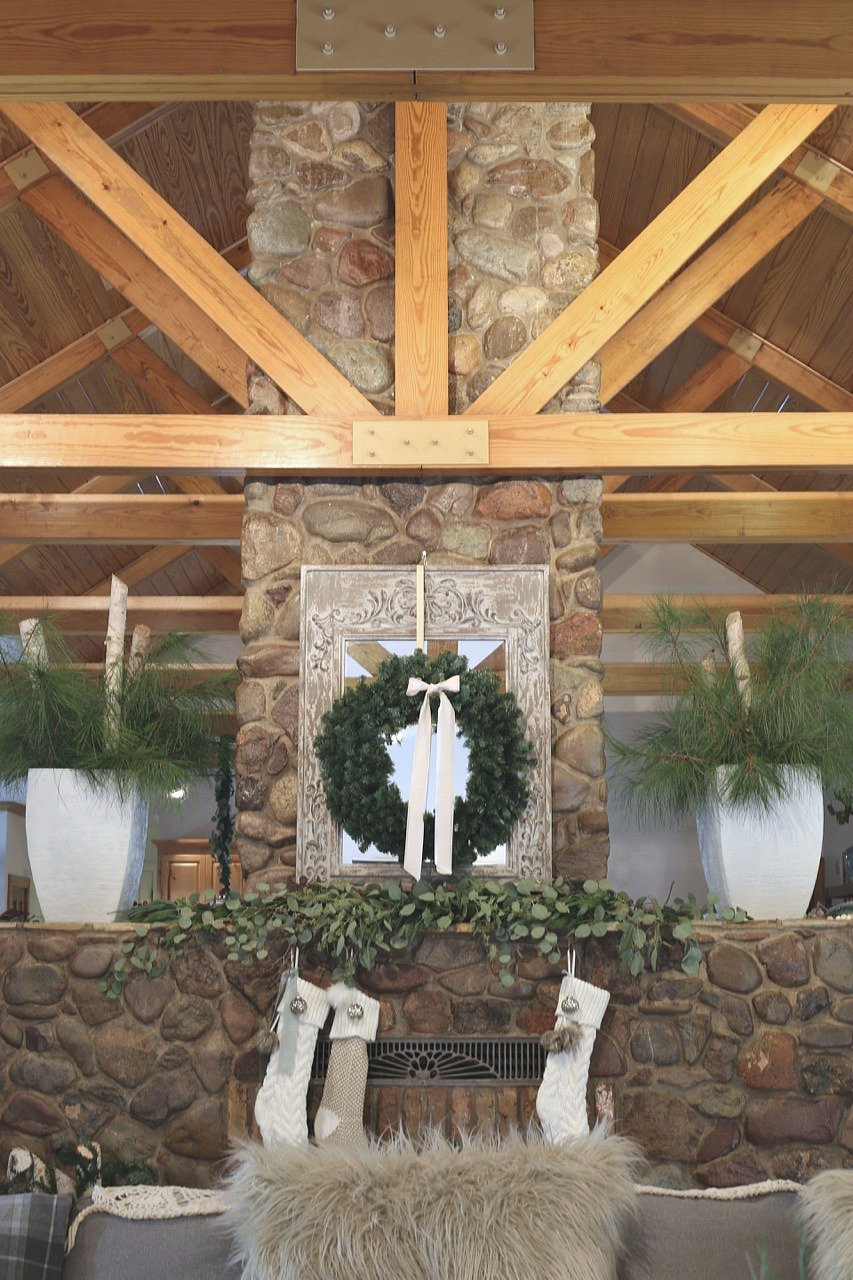 Stone fireplace with pine Christmas urns
