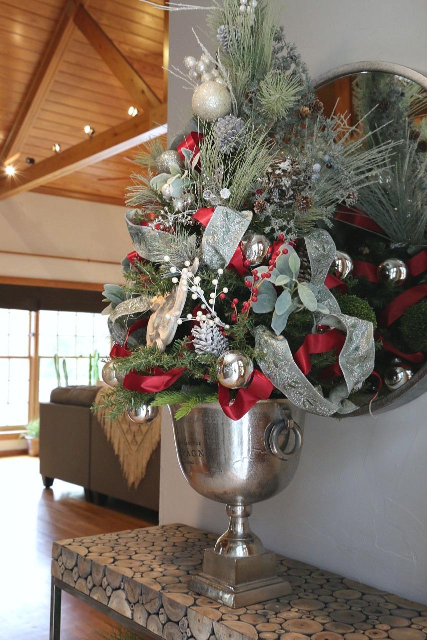 Tabletop Christmas tree in entryway.