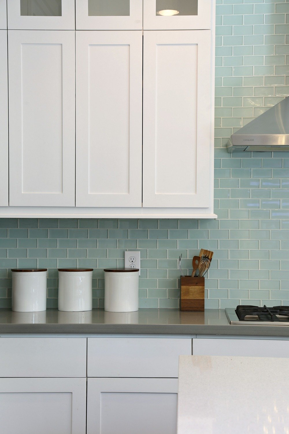 White-kitchen-cabinets-with-blue-green-subway-tile