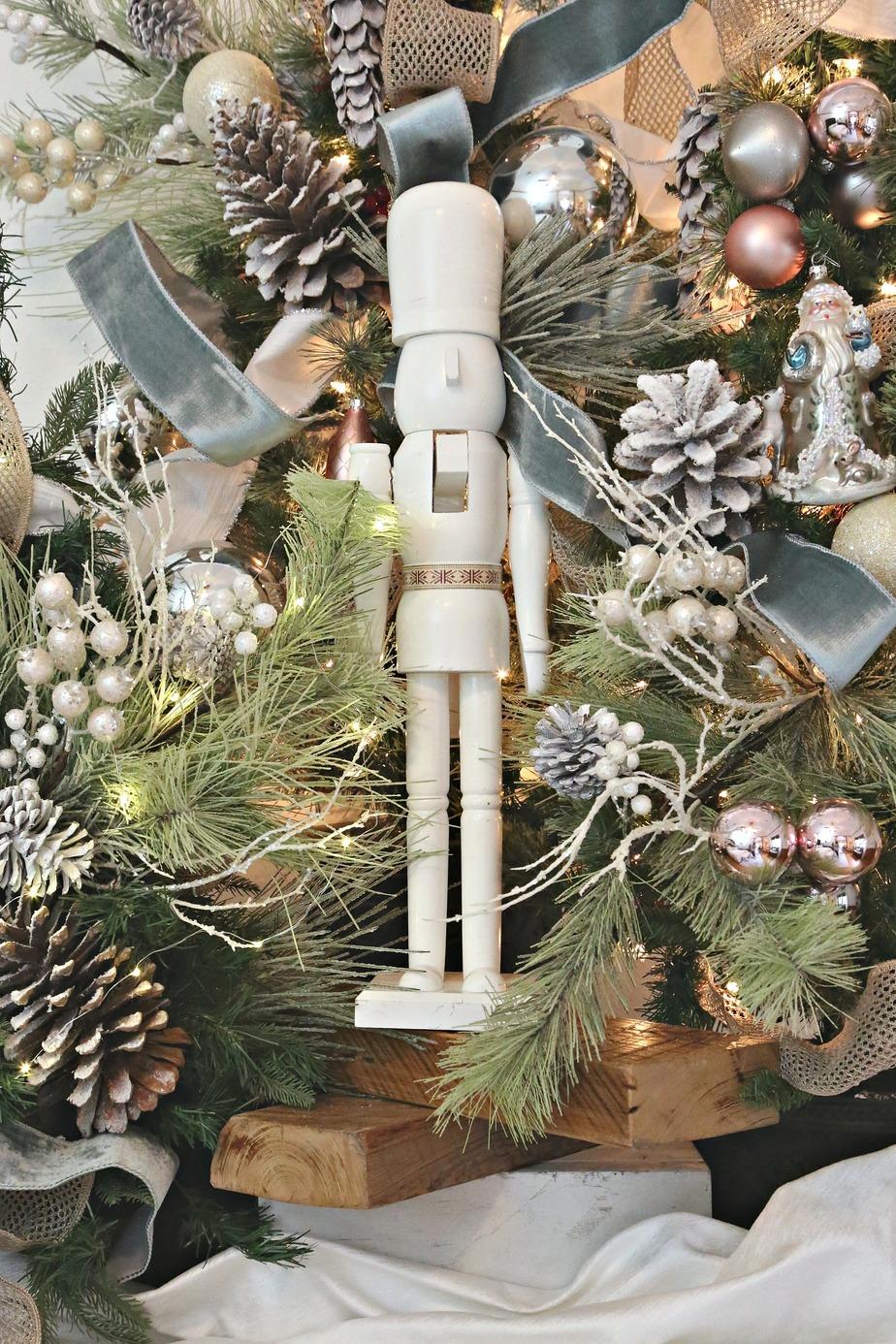 White nutcracker in Christmas tree.
