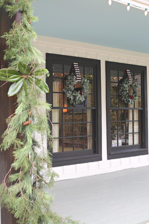 Wreath on windows. Modern Farmhouse Christmas Home Tour
