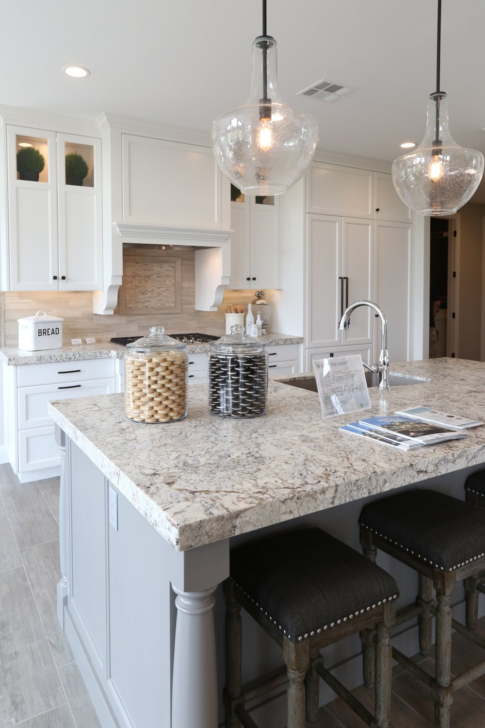 Open kitchen design with white cabinetry