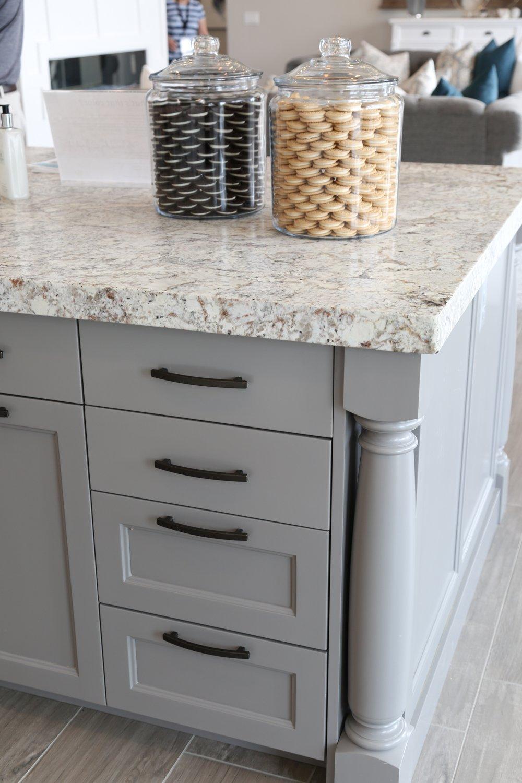 Gray Kitchen Island with Granite Countertops