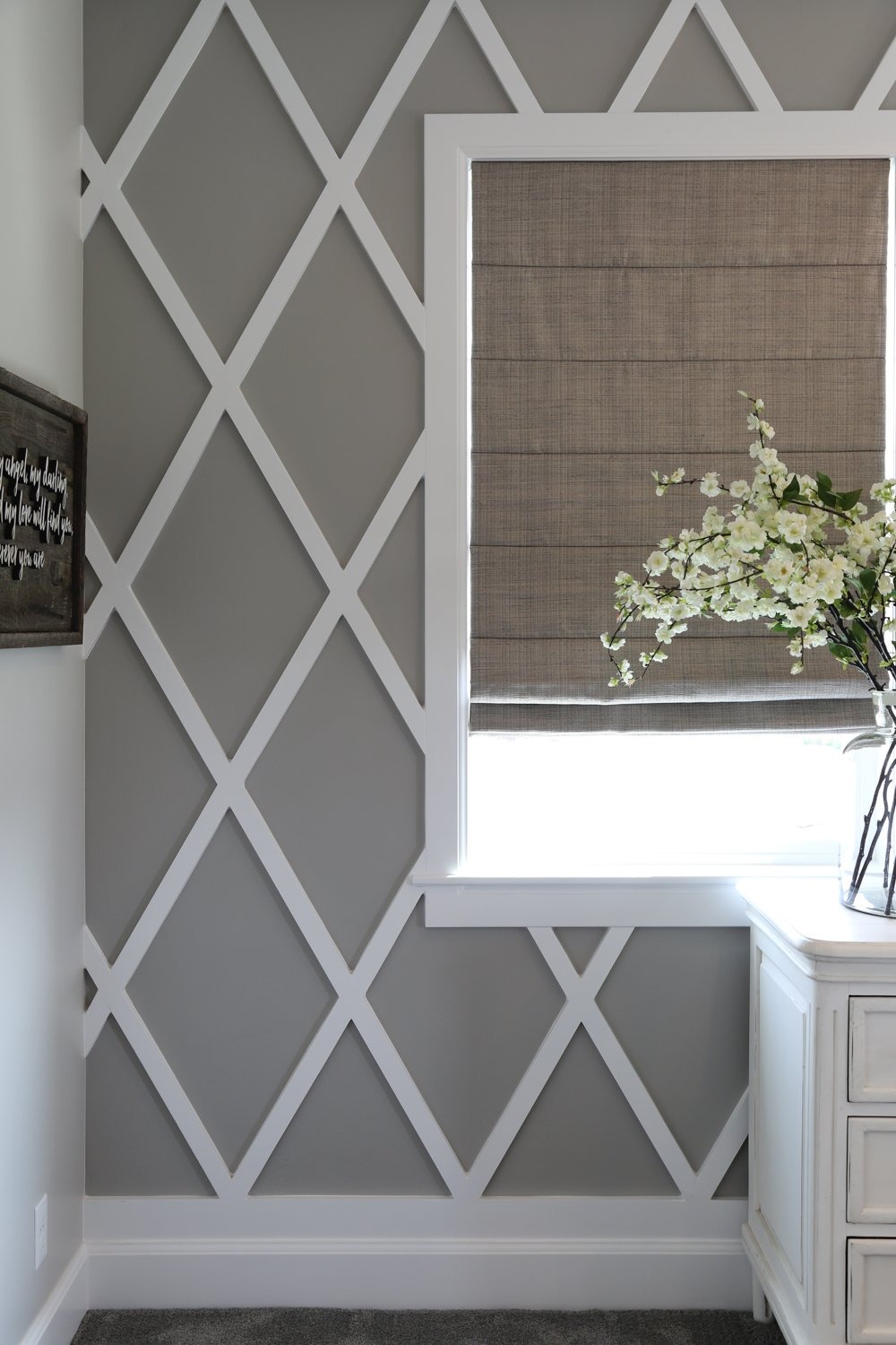 Trim attached to wall to created raised diamond pattern.