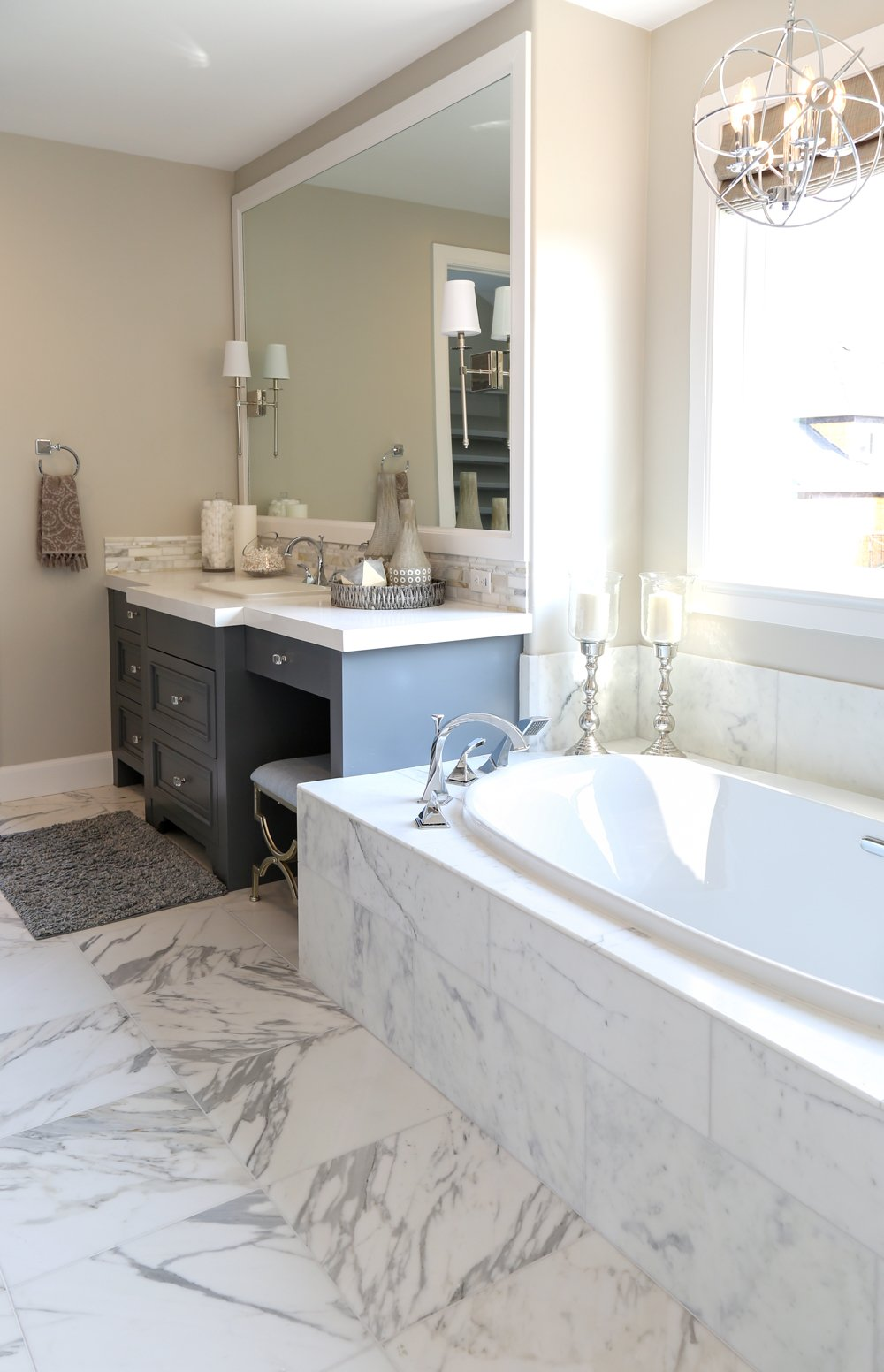 Master bathroom with marble tub and floors