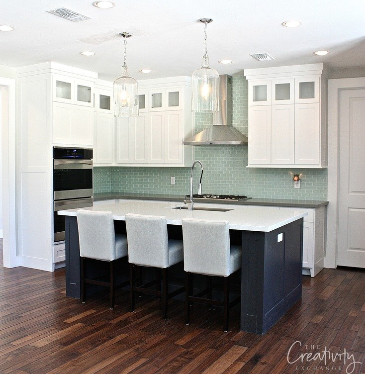 The cabinet is painted Benjamin Moore Decorators White and Benjamin Moore Wrought Iron