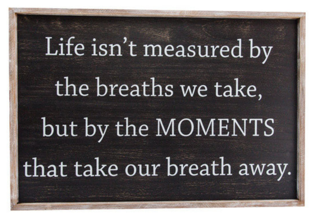 Life isn't measured by moments wood sign