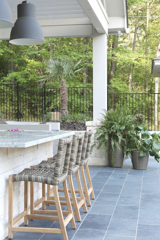 Black slate outdoor tile in outdoor kitchen.