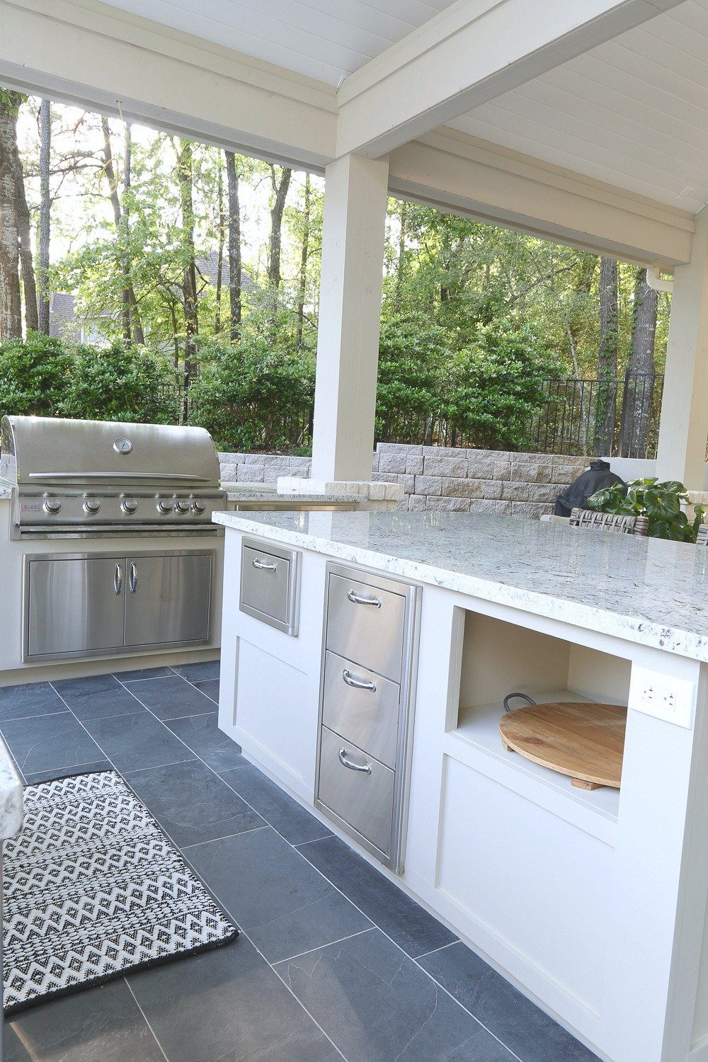 Outdoor kitchen with large grill and stainless drawers