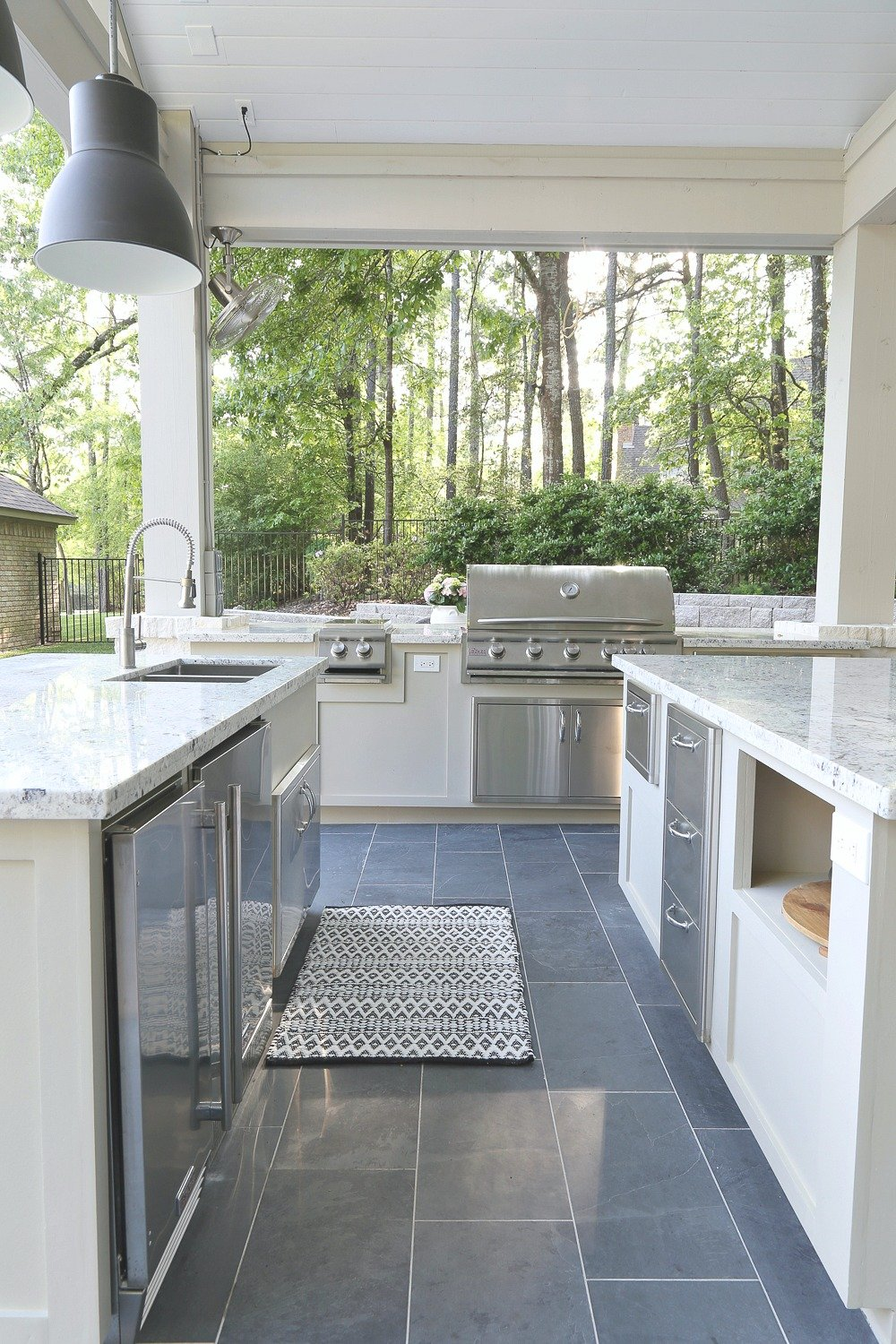 Outdoor kitchen with large grill, burners and stainless drawers