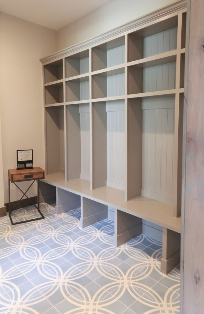 Floor to ceiling shelving for mudroom
