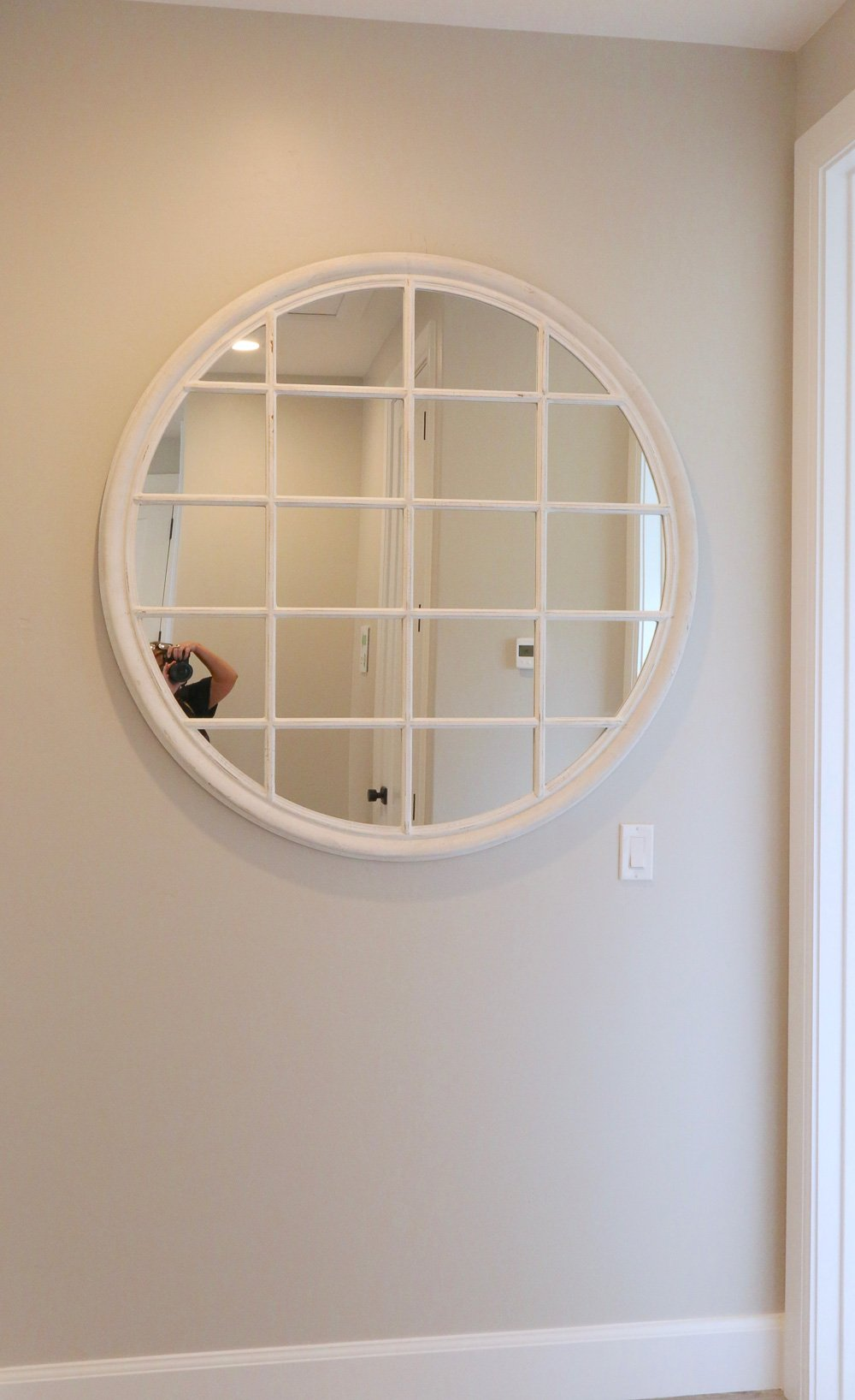 Round mirror window pane