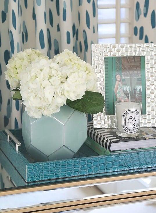 Bedroom nightstand decor. Vase and flowers