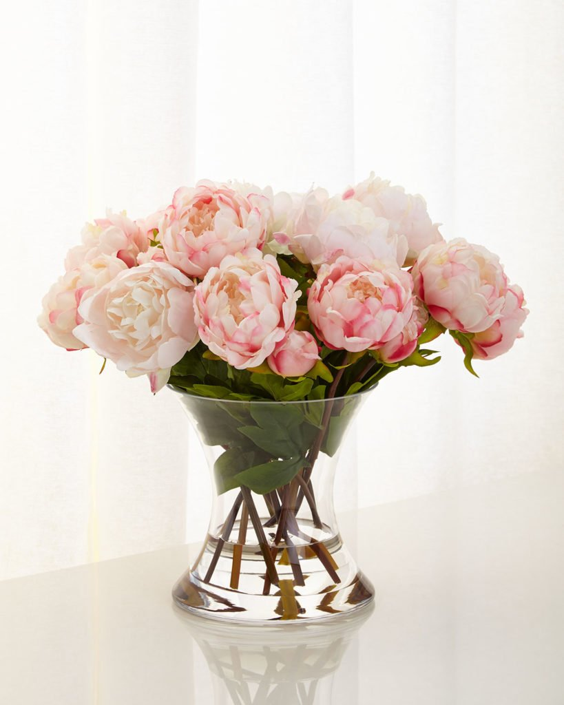 Faux peony arrangement in glass vase