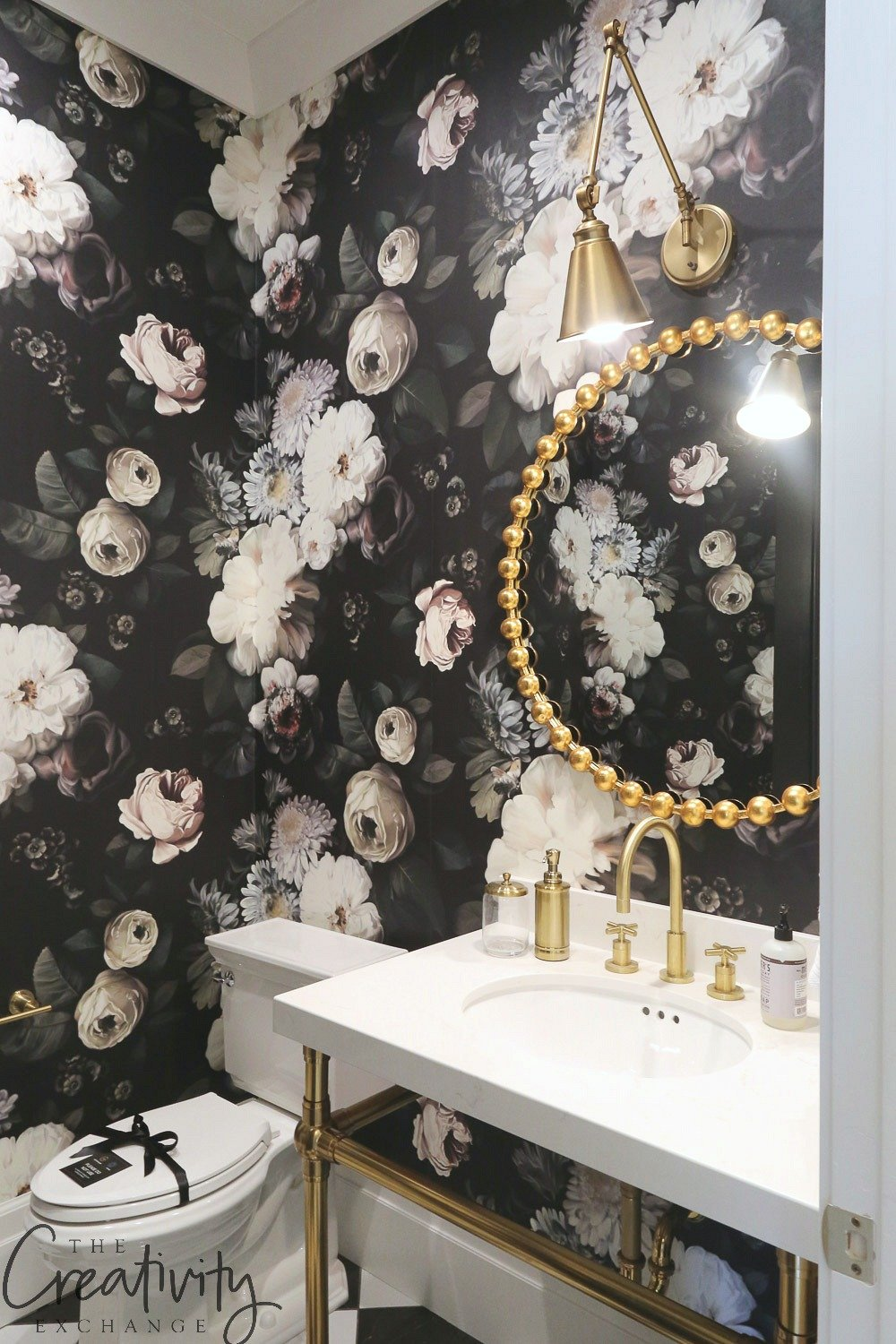 Black and white floral powder room wallpaper.