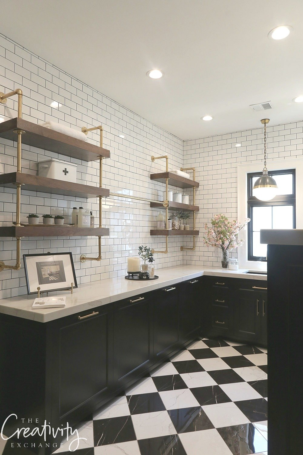 Black and white laundry room with open shelving
