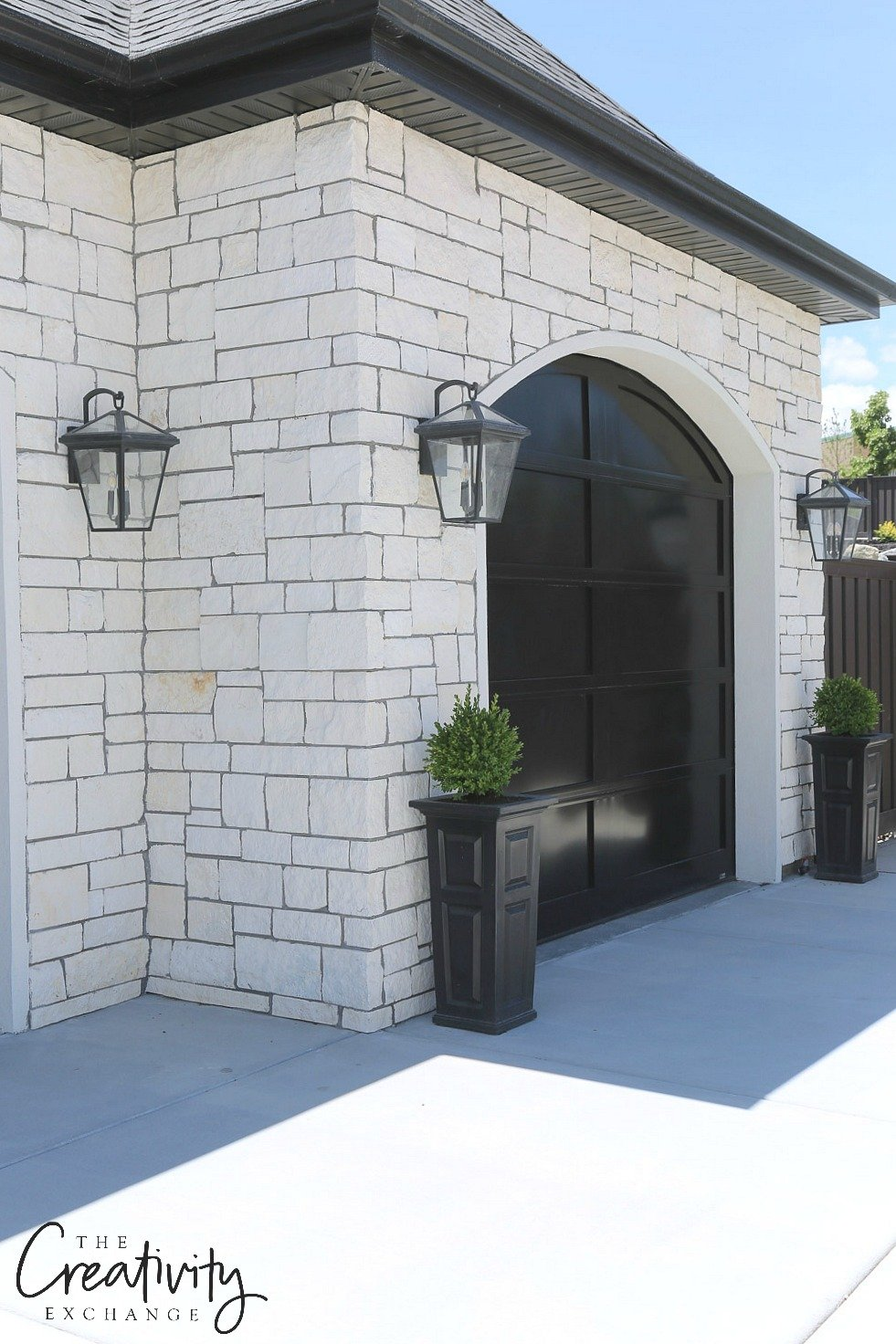 Modern French exterior black garage. Shelby Homes.