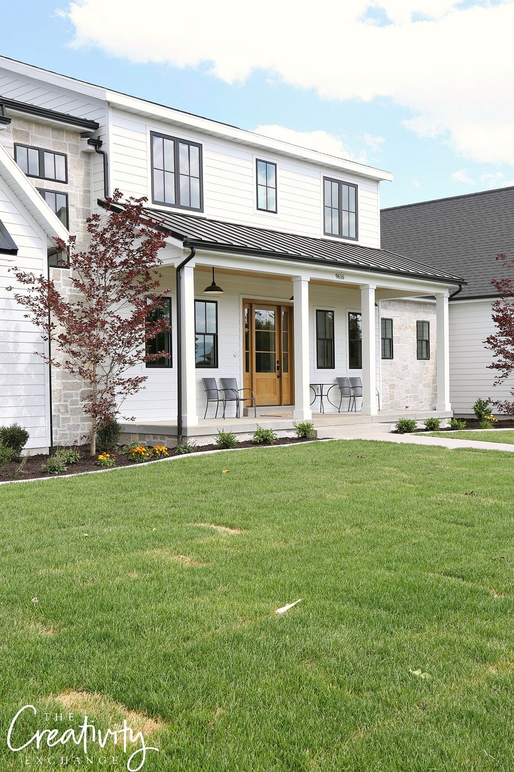Modern White Farmhouse Exterior Built by Millhaven Homes